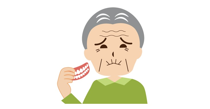 入れ歯を外した初老の男性